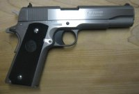 No SN 23   .45 ACP Colt 1911 O1091   100 years of Service.jpg