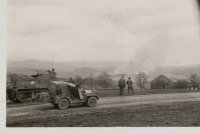 a153 - Col Yale observing town under our artillery fire..jpg