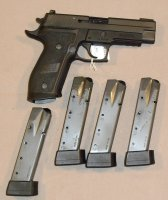 p226r_tac_ops_9mm_right_side_with_mags[1].jpg