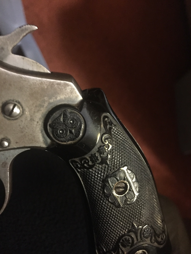 Grip Showing Hammer and Owl Logo.jpg