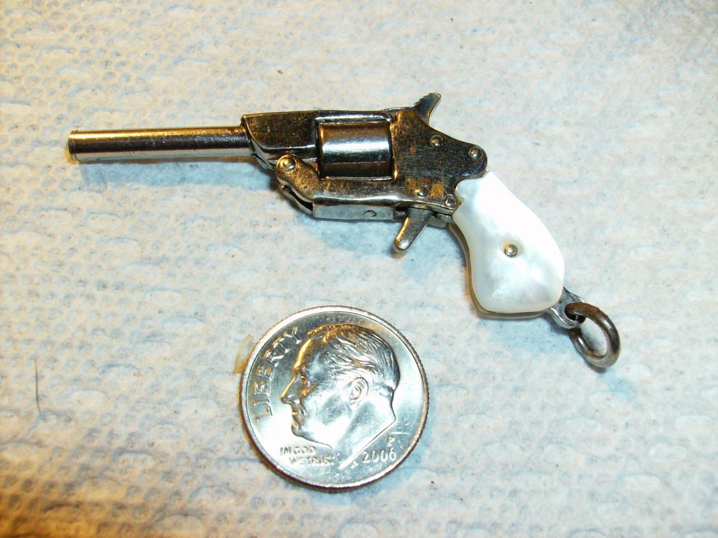 What's the current value of this miniature antique pistol